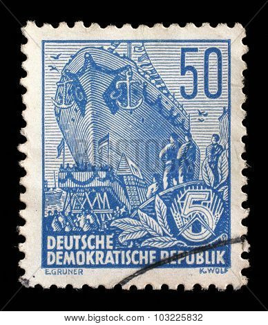 GDR - CIRCA 1955: A stamp printed in GDR, shows an Ocean-going ship on stack, series Five-year plan, circa 1955