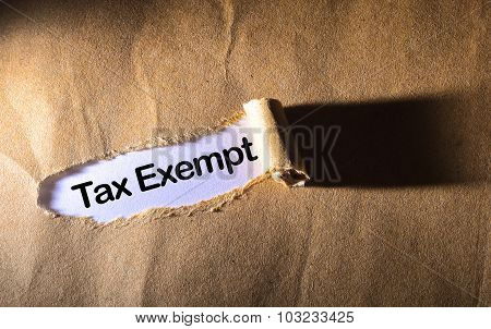 Torn Paper With Word Tax Exempt