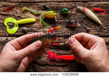 Man Holding A Fishing Bait And Fishing Line