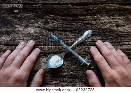 Male Addict Syringe And Heroin In A Spoon In The Shape Of A Cross
