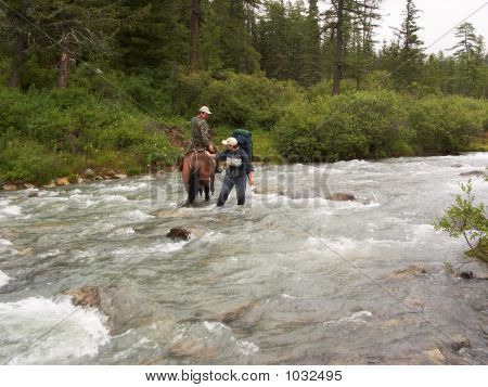 Horseman And Woman Crossing Mountain River