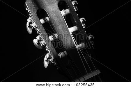 Close-up of guitar strings on a guitar fretboard
