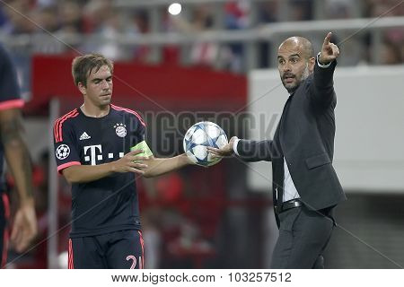 Philipp Lahm (l) Taking The Ball From Coach Josep Guardiola (r) During The Uefa Champions League Gam
