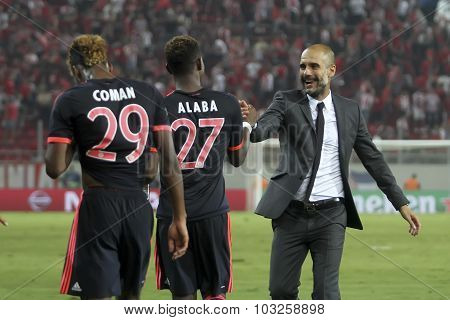 Coach Josep Guardiola Celebrates With The Players Of Bayern Munchen During The Uefa Champions League