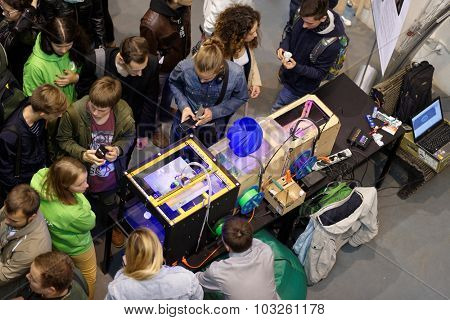 ST. PETERSBURG, RUSSIA - SEPTEMBER 19, 2015: People at the Fab Lab Polytech area during PolyFest. It's the Europe largest university festival of scientific achievements of young people