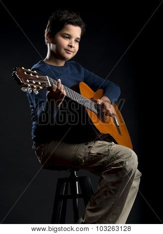 Child Guitarist with Negative Space