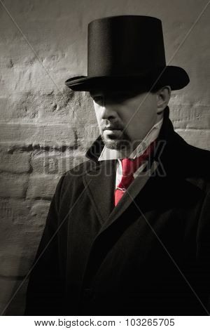 Man In The Black Coat, Top Hat And In A Red Tie