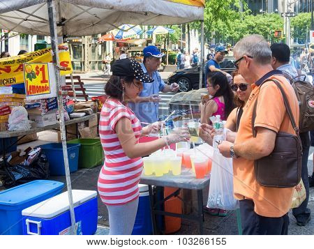 NEW YORK,USA - AUGUST 15,2015 : Stand selling food at a street fair next to the Rockefeller Center in New York City