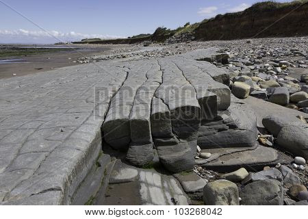 Doniford Bay consists of the Lower Jurassic Lias and Triassic beds.The Jurassic lias at Doniford are the youngest of the lias at Somerset and marks the uppermost beds of the Lower lias. Horizons of the Doniford Shale's can be located and at low tide  poster