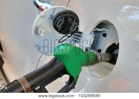 Opened Tank And Gun Of Gas Station. Fuelling Gasoline In Car