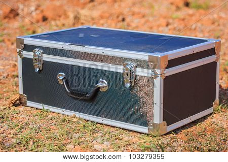 Suitcase Left On A Dirt Road