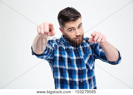 Portrait of a handsome man pointing fingers at camera isolated on a white background