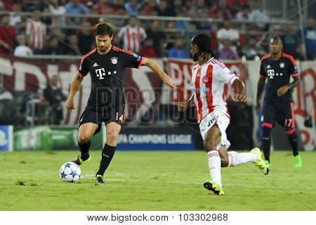 Xabi Alonso During The Uefa Champions League Game Between Olympiacos And Bayern, In Athens, Greece.