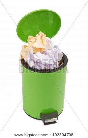 Waste can full up with crumpled paper. Isolated on white backgro