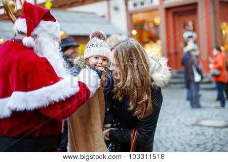 Little Toddler Girl With Mother On Christmas Market.