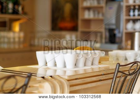 White Coffee Cups On Bar Table Of A Cafe
