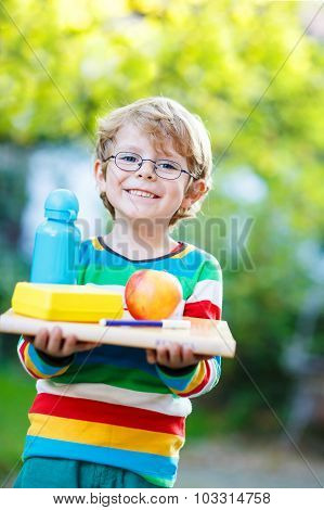 Happy School Boy With Books, Apple And Drink Bottle