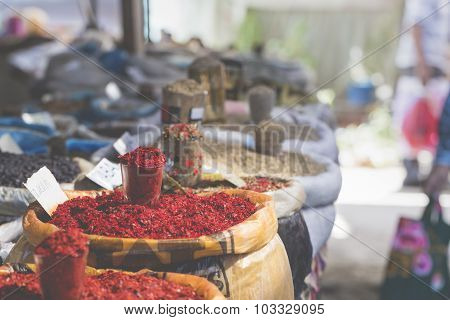 Vivid oriental central asian market with bags full of various spices in Osh bazar in Bishkek Kyrgyzstan. poster