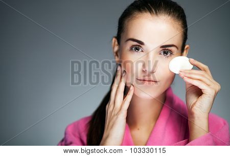 Beauty fresh girl cleaning face with cotton swab poster