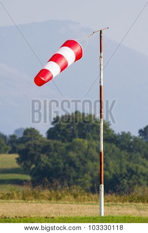 Windsock In Green Field Background And Grass