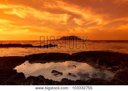 Sunset seascape and volcano, Cheju island, Korea.
