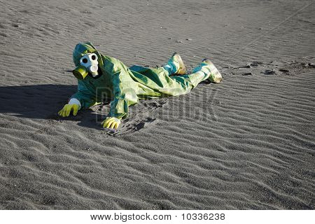 Man In Gas Masks Crawling On Poisoned Soil