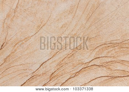 Texture of a beige and brown stone slab