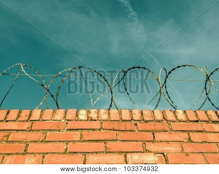 Barbed Wire On A Brick Wall