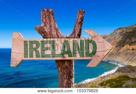 Ireland wooden sign with coast background