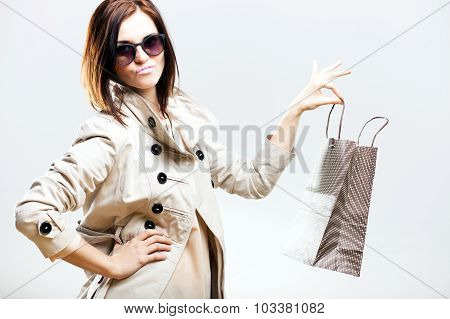 Unhappy Woman Holding Shopping Bag