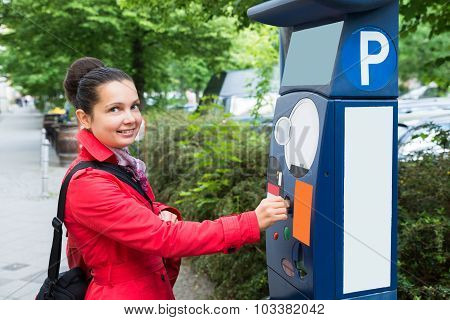 Young Beautiful Woman Inserting Coin In Parking Meter poster