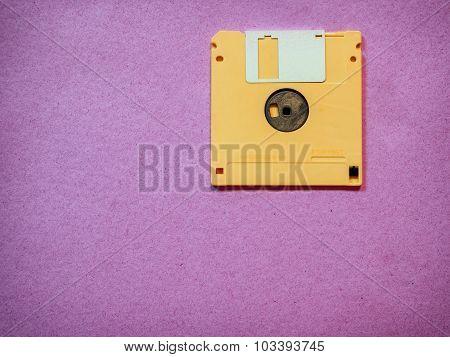 Vintage yellow floppy disk
