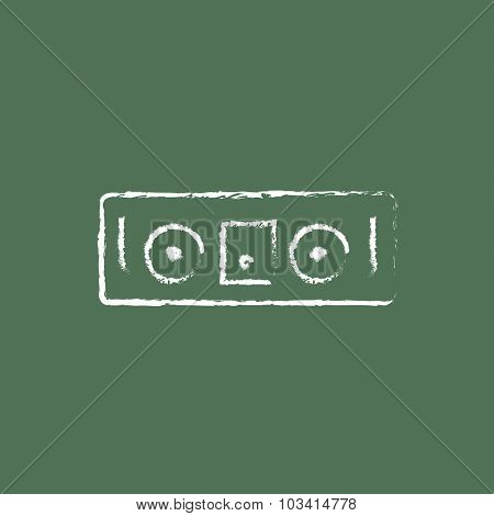 DJ console hand drawn in chalk on a blackboard vector white icon isolated on a green background.