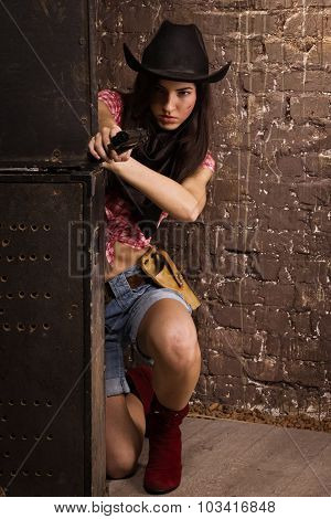 A Girl cowboy shoots from a revolver poster