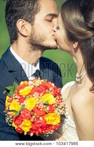 Bride And Groom Kissing Each Other Outside