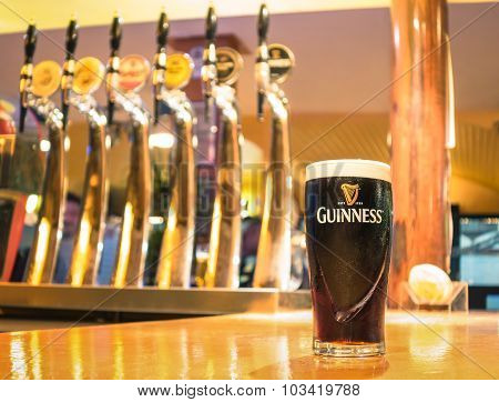Rimini, Italy - October 11, 2014: Pint Of Beer Served In A Pub. Guinness Is World Famous Irish Stout