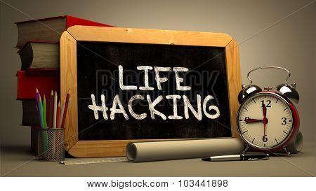 Life Hacking Handwritten on Chalkboard.
