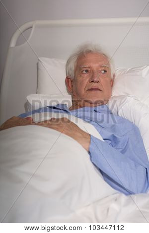 Elder Man In Hospital Bed
