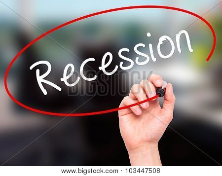 Man Hand writing Recession with black marker on visual screen