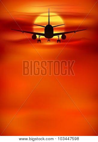 Orange sunset background with black plane silhouette