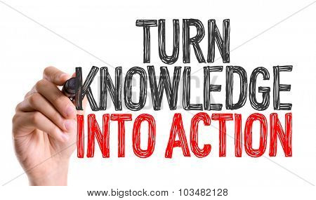 Hand with marker writing: Turn Knowledge into Action