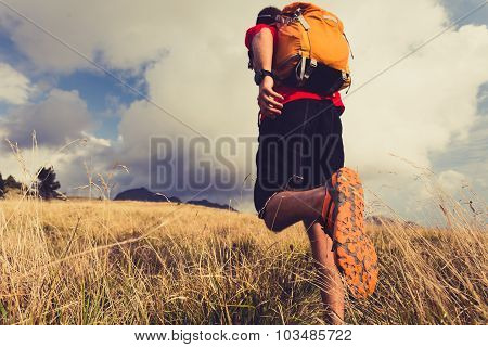 Hiking man or trail runner walking in mountains. Travel in Italy Europe. Fitness and healthy lifesty