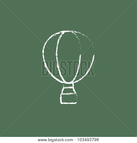 Hot air hand drawn in chalk on a blackboard vector white icon isolated on a green background.