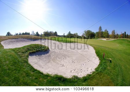 Sand Bunkers On Golf Course Landscape View