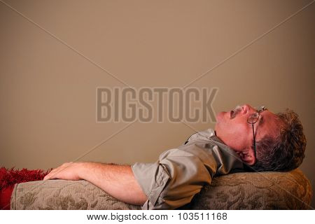 Man sleeping on the couch