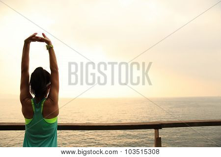 fitness sports woman runner stretching on wooden boardwalk seaside poster