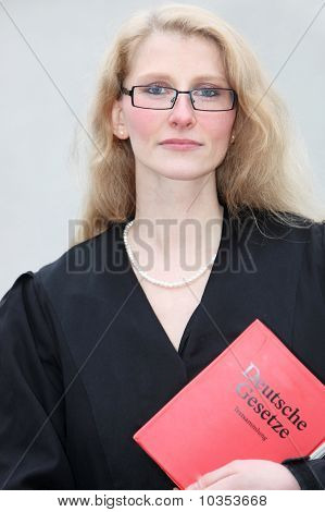 Young Lawyer With The Law Book Looks