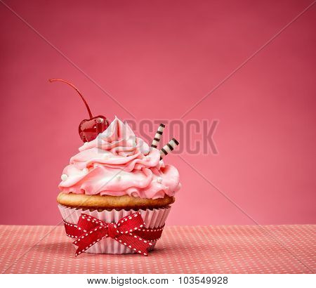 Pink Cupcake With Cherry On Top