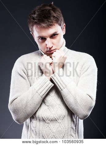 Young Man In White Sweater Shivering From Cold