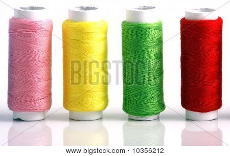 Set of colorful spools of thread